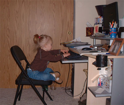 Picture of Adrianna working on the computer