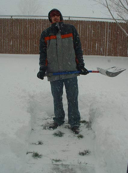 Greg shovels the snow