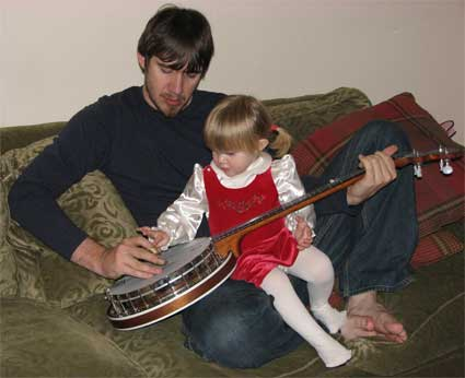 Greg and Adrianna play the banjo
